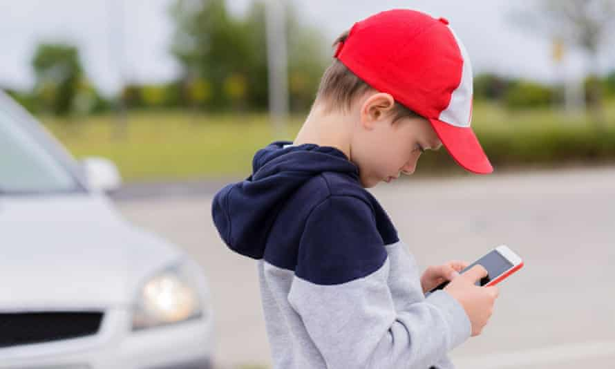 A child playing games on a smartphone