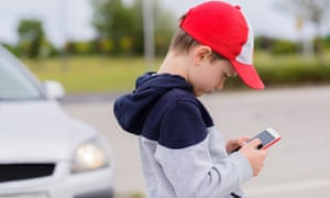 Child playing games on a smartphone