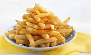 Pile of French fries on a plate.