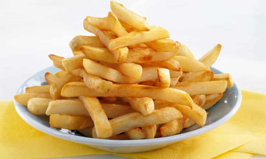 Pile of French fries, chips on plate