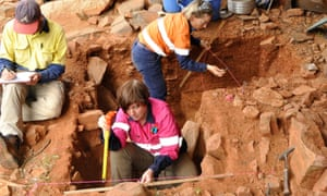 Jo McDonald, centre, excavating at a Murujuga rock shelter in Western Australia. Artefacts uncovered in the past year show human occupation dating back 21,000 years.