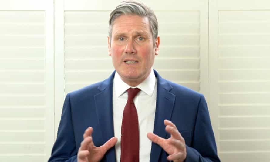 TV grab of Starmer in suit and tie, holding hands up and looking concerned.