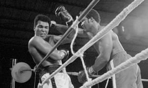 Muhammad Ali leans back over the ropes, fending off George Foreman