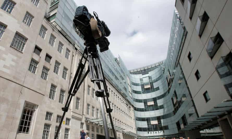 A television news camera points at the main entrance to the BBC headquarters in Portland Place, London.