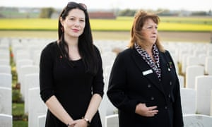 """icola Nash, left, an archaeologist and """"war detective"""" at the Joint Casualty and Compassionate Centre, Tracey Bowers, at the burial ceremony Tyne Cot Cemetery, near Ypres in Belgium."""