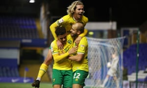 Teemu Pukki is grabbed by Max Aarons and jumped on by Todd Cantwell after scoring his and Norwich's second at Birmingham.