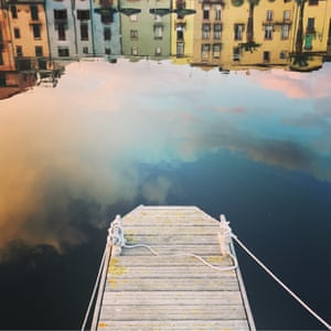 Dusk on a windless day in Bosa, Sardinia. Walking along the river through town, I noticed the beautiful multicoloured buildings reflected without a ripple in sight. The jetty makes a great balance in the foreground and lead-in for the eye.