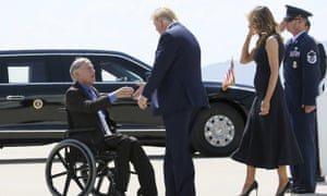 Donald and Melania Trump greet Greg Abbott after arriving in El Paso, Texas, in August.