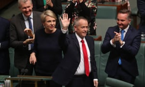 Bill Shorten waves to the galleries after delivering his budget reply speech on Thursday night.