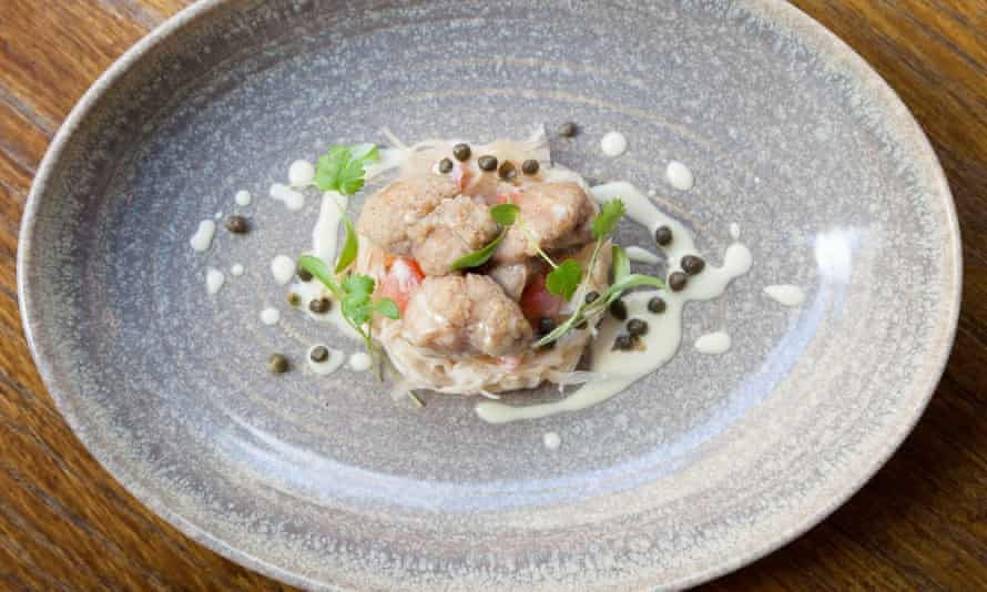 Sweetbreads on sauerkraut on a round bowled blue plate