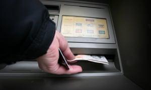 A man uses an ATM