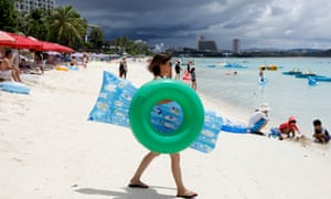 Tourists on Tumon beach on the island of Guam.