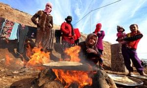 Yazidis displaced by Isis in a camp near Dohuk, Iraqi Kurdistan, January 2015