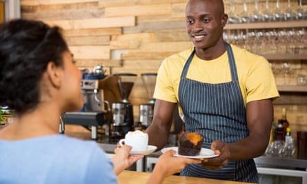 Barista serves coffee