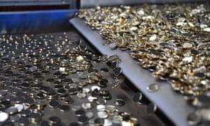 Blank coins on a conveyor belt