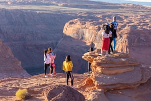 Tourist at the Horseshoe Bend overlook during sunset.