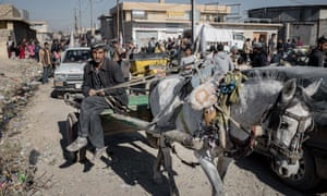 Shoppers at a street market in the Gogali neighbourhood of eastern Mosul.