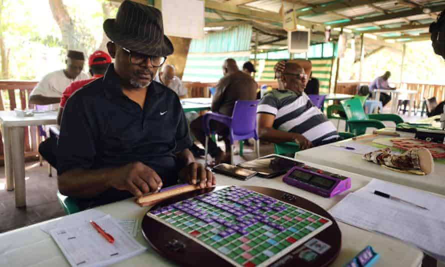 Anthony Ikolo, former president of the Nigeria Scrabble Federation, arranges his tiles during a competition in Abuja, January 2020.