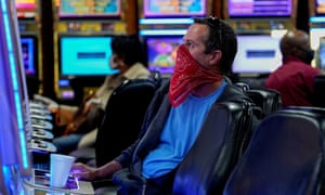 A man wearing a bandana plays a slot machine at the recently reopened Lucky Star Casino in El Reno.