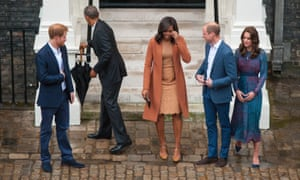 Braving the British weather: Barack Obama puts the umbrella aside before a photo opportunity with the First Lady alongside the younger royals.