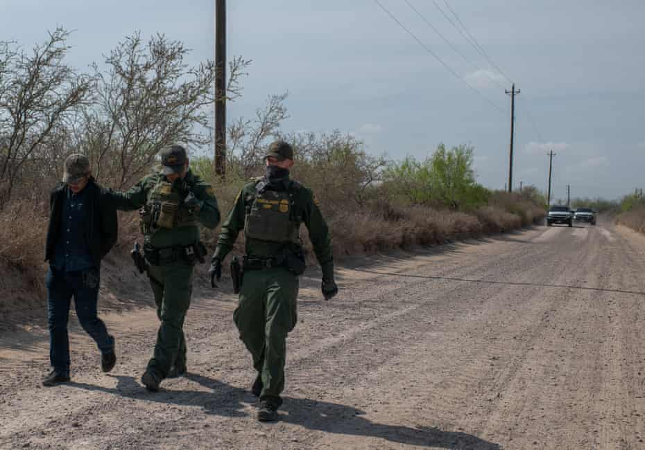 A man is detained while crossing the border in the Rio Grande Valley, Texas.