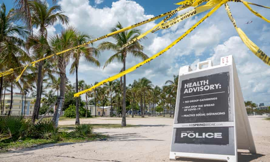 A health advisory in Miami Beach in March. Certain beaches in Florida have already reopened to the public.