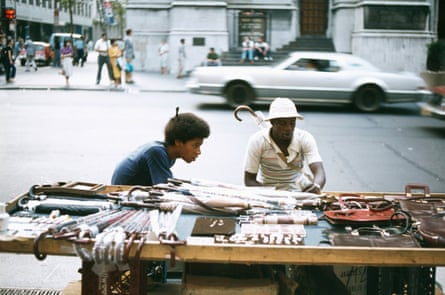 Street vendors selling an array of umbrellas, leather bags, watches and sunglasses on a New York street in 1979.