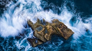 An outcrop of rock, battered by the waves, forms its own tiny island just off the coast of Taiwan