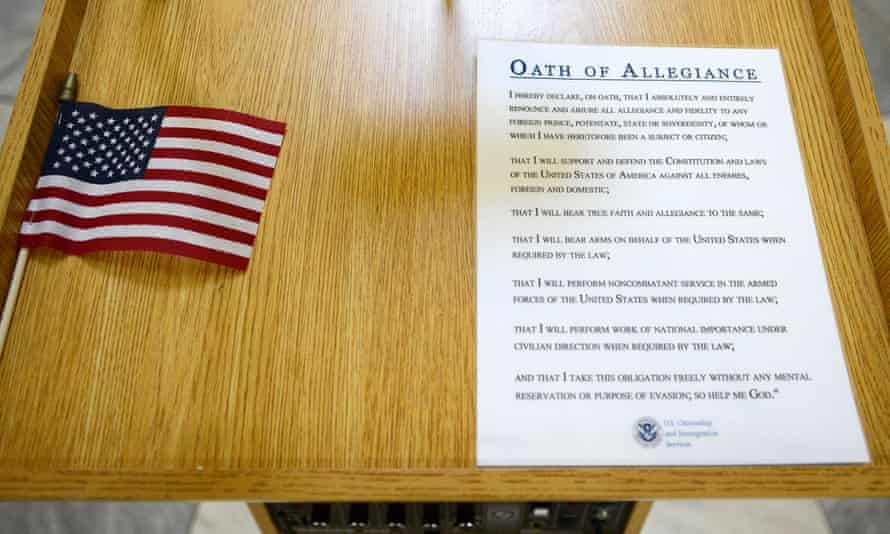 A flag and a copy of the Oath of Allegiance on a podium at a US citizenship ceremony