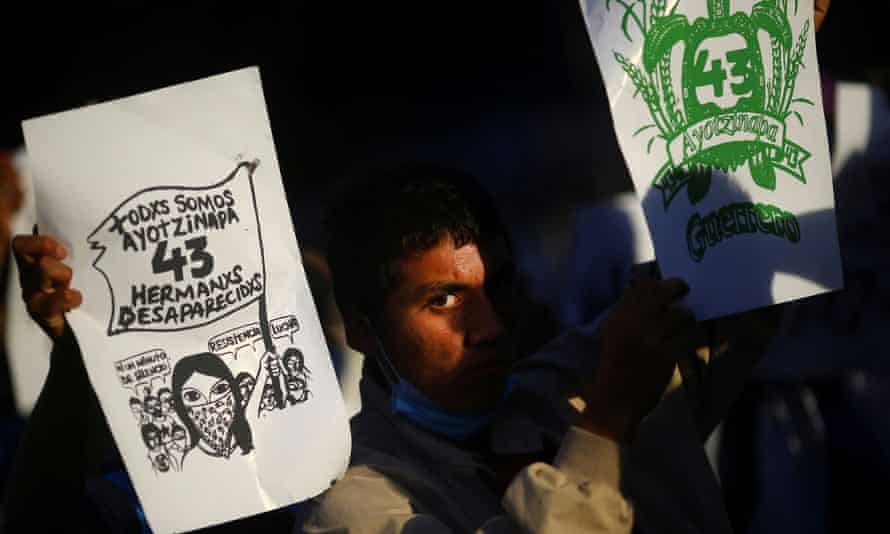 A student looks on in November as family members mark the 74th month since the disappearance of 43 student teachers from the Ayotzinapa Rural Teachers' College.