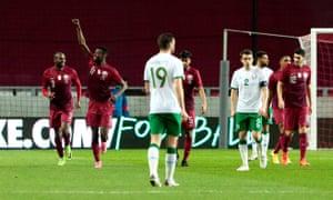 Qatar's Mohammed Muntari (second left) celebrates scoring their equaliser.
