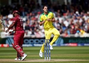 Pat Cummins celebrates taking the wicket of Evin Lewisfor one.