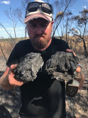 Ecologist Pat Hodgens with burned wildlife-monitoring cameras on Kangaroo Island.