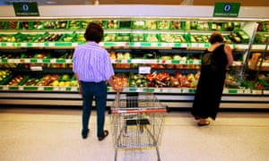 Customers shop for organic fruit and vegetables in Waitrose