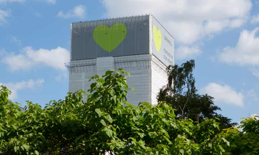 Grenfell Tower a year on, with cladding and a green heart