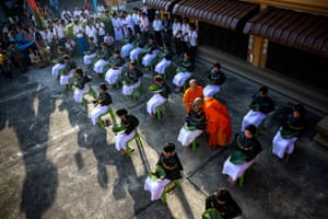 Thai women devotees have their hair cut