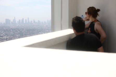 People visit Griffith Observatory on a day rated 'moderate' air quality in Los Angeles, California, in June 2019.
