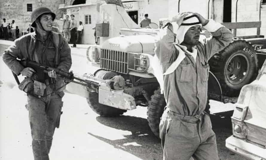 An Israeli soldier with a Jordanian found without identification papers in Bethlehem during the six-day war.