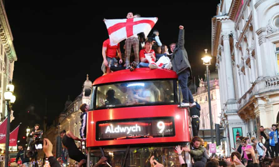 Fans celebrate on a bus in central London after England defeated Denmark.