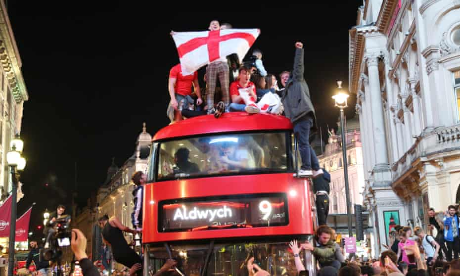 Fans celebrate on a bus in London after England defeated Denmark 2-1 on Wednesday to reach the Euro 2020 final.