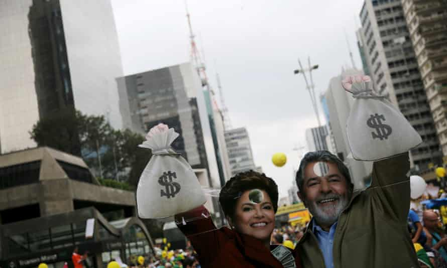 Cardboard cutouts depicting Brazil's former president Lula da Silva and president Rousseff are seen during nationwide protests calling for her impeachment.