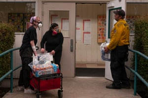 Volunteers with the Portland mutual aid group PDX Witches deliver donated supplies to a fire command center on 10 September 2020 in Molalla, Oregon