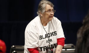 A woman waits for President Donald Trump to arrive for a Black Voices for Trump rally Friday, Nov. 8, 2019, in Atlanta. (AP Photo/John Bazemore)