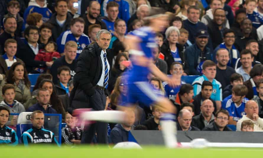 Filipe Luis runs past José Mourinho in 2014. 'I didn't want to work for Mourinho another year. But I tell you: it wasn't just Mourinho's fault.'