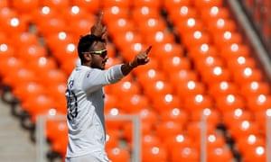 Axar Patel celebrates taking the wicket of Dom Bess