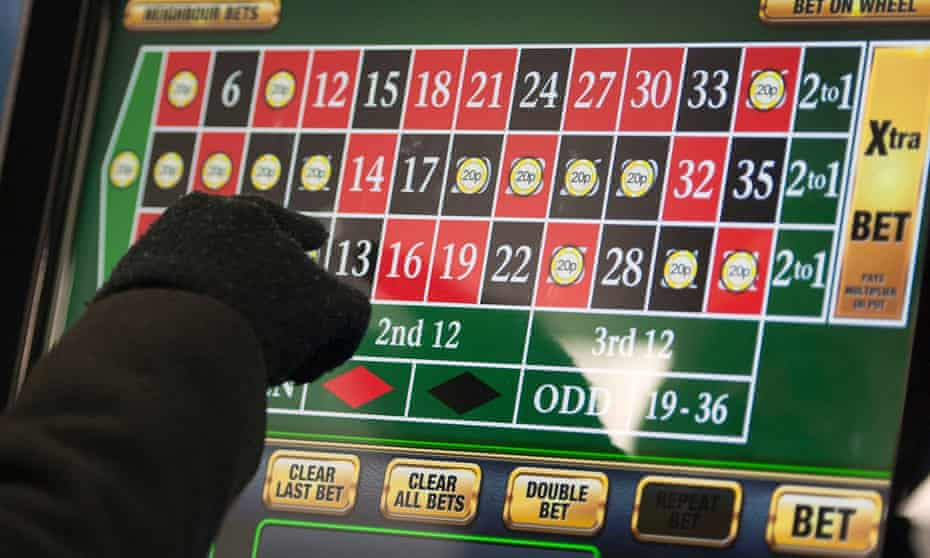 A person using a betting machine