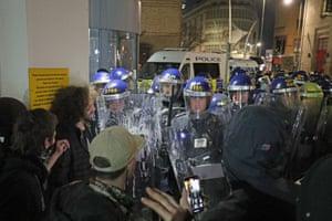 Police hold back ptotestors outside Bridewell police station.