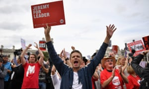 Supporters of Labour leader Jeremy Corbyn hold up signs and shout during Momentum's 'Keep Corbyn' rally outside the Houses of Parliament on June 27.