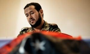 Abdel Hakim Belhaj with Libyan flag