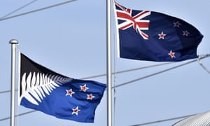 The current New Zealand flag (R) flutters next to the alternative flag (L) in Wellington on March 4, 2016.